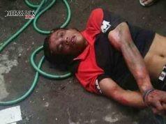 DIAMANKAN:Suyono, pelaku pembacokan Kiai Ahmad Zaenuri, tokoh NU di Kecamatan Kangkung, Kabupaten Kendal dan menantunya Agus Nurus Sakban tampak diamankan polisi setelah sempat diamuk massa.