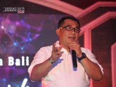 : Vice President Business Support Area Jawa Bali Telkomsel, Frangky Daniel Pandensolang